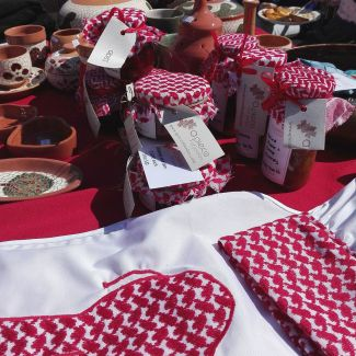 Locally made produce display at a bazaar in Jordan