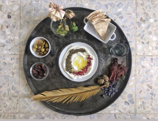 Homemade olive oil, local labaneh, pomegranate, olive, dates and dried flower by @tanya_marar
