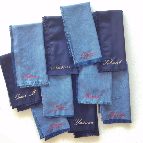A collaboration with Reverie: raw edged denim linen napkins with custom embroidery of each guest's name